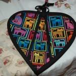 Hjärtformad kattgrytlapp