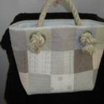 Väska med rephandtag
